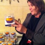 Lynne Reid of Homestead Realty checking out the Staying in Touch cupcakes.